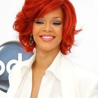 Rihanna Short Layered Red Curly Bob Hairstyle with Bangs