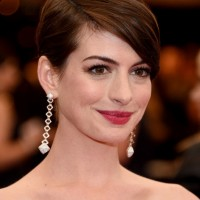 Anne Hathaway Side Parted Straight Hairstyle with Bangs