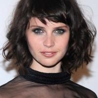 Felicity Jones Short Messy Dark Curly Hairstyle