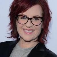 Megan Mullally Short Messy Red Hairstyle for Women Over 50