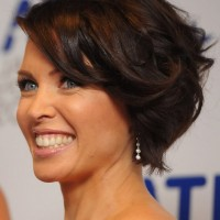 Side View of Dannii Minogue Brunette Curly Bob Hairstyle