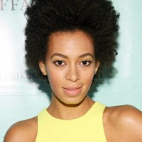 Solange Knowles Cool Trendy Short Curly Haircut for Black Women