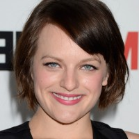 Elisabeth Moss Chic Short Haircut with Side Swept Bangs for Summer