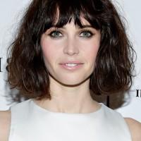 Felicity Jones Short Wavy Haircut with Choppy Bangs