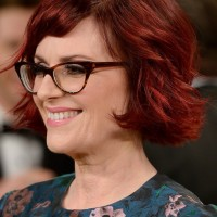 Side View of Megan Mullally Layered Red Razor Cut