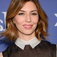 Sofia Coppola Short Red Wavy Hairstyle for Fall