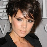 Victoria Beckham Short Wavy Hairstyle with Bangs for Fall